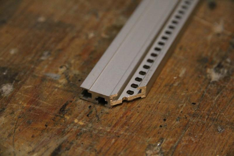 Outer, bottom rail with sawed off edge